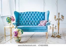 teal blue leather sofa blue leather sofa golden candlestick vase stock photo 474824668