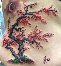 collection of 25 cherry blossom tree crane tattoos on back