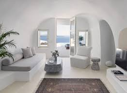 livinf spaces cave like villa in greece hides sculptured living spaces