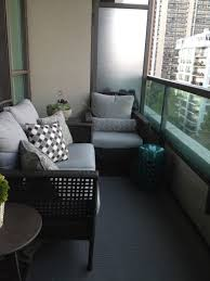 condo balcony decorating ideas with grey carpets and sofa also