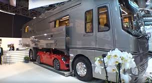 volkner rv 1 6 million luxury motorhome will carry you and your sports car in
