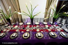 white gold and purple wedding black gold purple white centerpieces chairs indoor reception