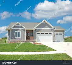 Building A Home In Michigan by Suburban Home Beautiful Vinyl Siding Home Stock Photo 11959690