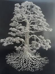artist makes intricate tree sculptures by twisting single strands of