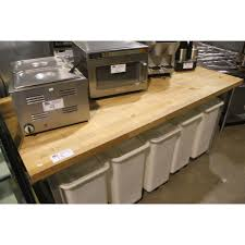 butcher block bakers table with mobile flour bins