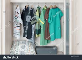 colorful clothes hanging on rail wooden stock photo 556839166