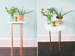 this diy copper pipe side table is perfect for small spaces via