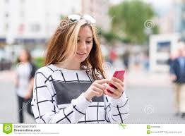 beautiful girl using smart phone in the street modern lifestyle royalty free stock photo