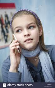11 year old girl an 11 year old girl with her mobile phone stock photo 30786323 alamy