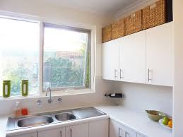 kitchen cabinet top storage 21 tips for organizing your stuff above kitchen cabinets