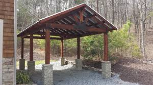 carport design with stone column bases creative faux panels timber carport design with stacked stone column wraps installed around the base of each supporting post