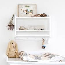 white wall mounted bookshelf with hooks by nubie modern kids