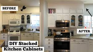 how to make cabinets appear taller diy stacked cabinets extending kitchen cabinet trim to ceiling
