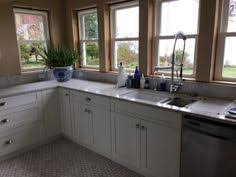 kraus pull out kitchen faucet stainless farmhouse drop in sink shelves instead of cabinets