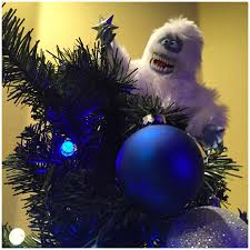 tree toppers a monkey white with grey