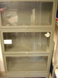 Bookshelves With Glass Doors For Sale by For Sale Metal Bookcase With Glass Doors Sold