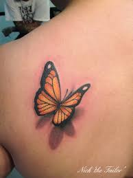 orange 3d butterfly on the shoulder tattoos