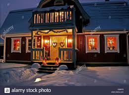 House With Front Porch Christmas Decorated Swedish House With Front Porch At Night Stock
