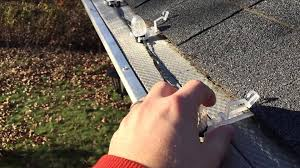 how to hang christmas lights on gutters installing christmas lights with gutter guards youtube