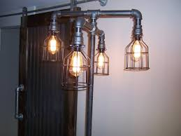 iron pipe floor lamp steampunk design by thehoneydew on etsy