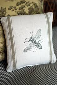 grain sack pillow with bumble bee print country charm