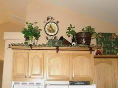 Above Kitchen Cabinets Ideas Lady Goats Decorating Above Kitchen Cabinets With Ivy U0026 Ferns