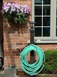 Hose Reel Solution For Yard And Garden Outdoor Faucet Extension Diy Hose Reel Diy Projects Ideas