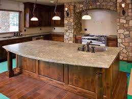 kitchen island types different types countertops for kitchen island with pendant lighting and arch stone range hood plus wall lamps also design ideas