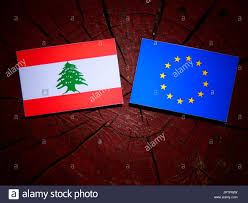 What Tree Is On The Lebanese Flag Lebanese Flag With Eu Flag On A Tree Stump Isolated Stock Photo