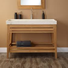 light brown wooden vanity with shelf also white sink placed on the