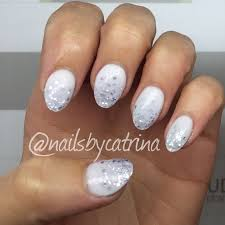 icy white and silver glitter fade almond shaped acrylic nails