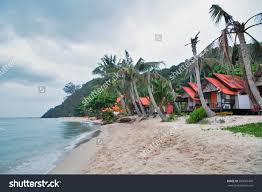 cheap bungalows backpackers on tropical beach stock photo