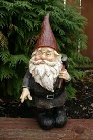 garden gnome key hider lawn ornament blue jacket left pant
