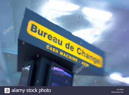 bureau de change sign at an airport stock photo royalty free image