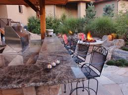 outdoor firepit outdoor countertop island black chair natural gas