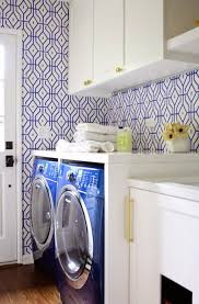 Laundry Room Decorating Ideas by Laundry Room With Blue Wash Machines And Wallpaper Laundry Room