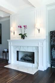 carrera marble fireplace surrounds wood work detail for