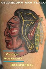 chicago blackhawks feathers logo tattoo by george zabala tattoo