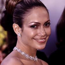 jlo earrings wearing 100 carat diamond cluster necklace and 10