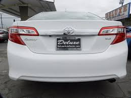 auto dealer toyota 2014 used toyota camry xle navigation at deluxe auto dealer
