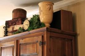 How To Decorate Above Cabinets by Common Ground Ideas On Styling A Cabinet Or Cupboard Top