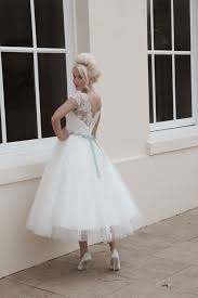 short calf length spot tulle weddubg dress with illusion neckline