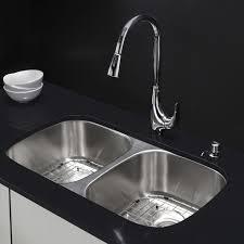 pretty backsplash tile idea plus unique biscuit kitchen faucet