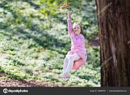 child swinging on tree swing u2014 stock photo famveldman