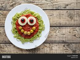 green spaghetti pasta creative halloween food monster with cute