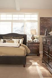 california king upholstered bed with brown woven fabric arched