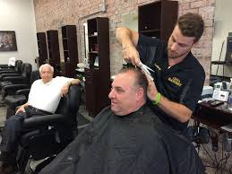 barber shop opens on up and coming downtown syracuse street