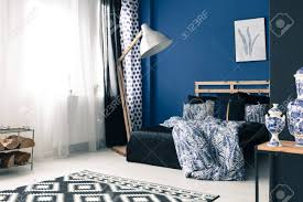 cobalt blue bedroom calming blue bedroom with wooden bed frame and cobalt wall stock