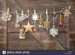 rustic wooden background with festive ornaments frohe