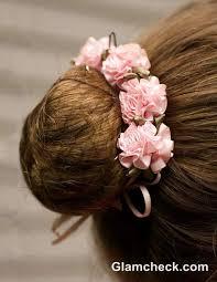 flower hair bun the ballerina bun with flowers flower hairstyles